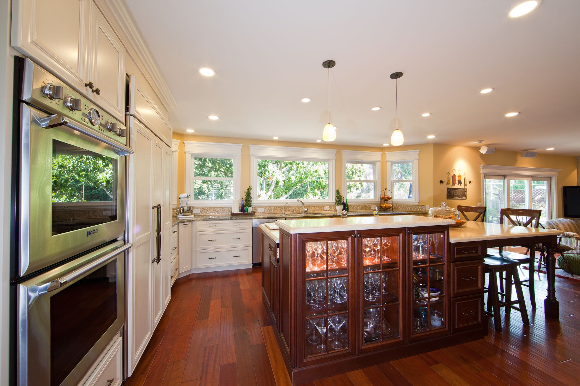 Open concept kitchen with island display cabinets.