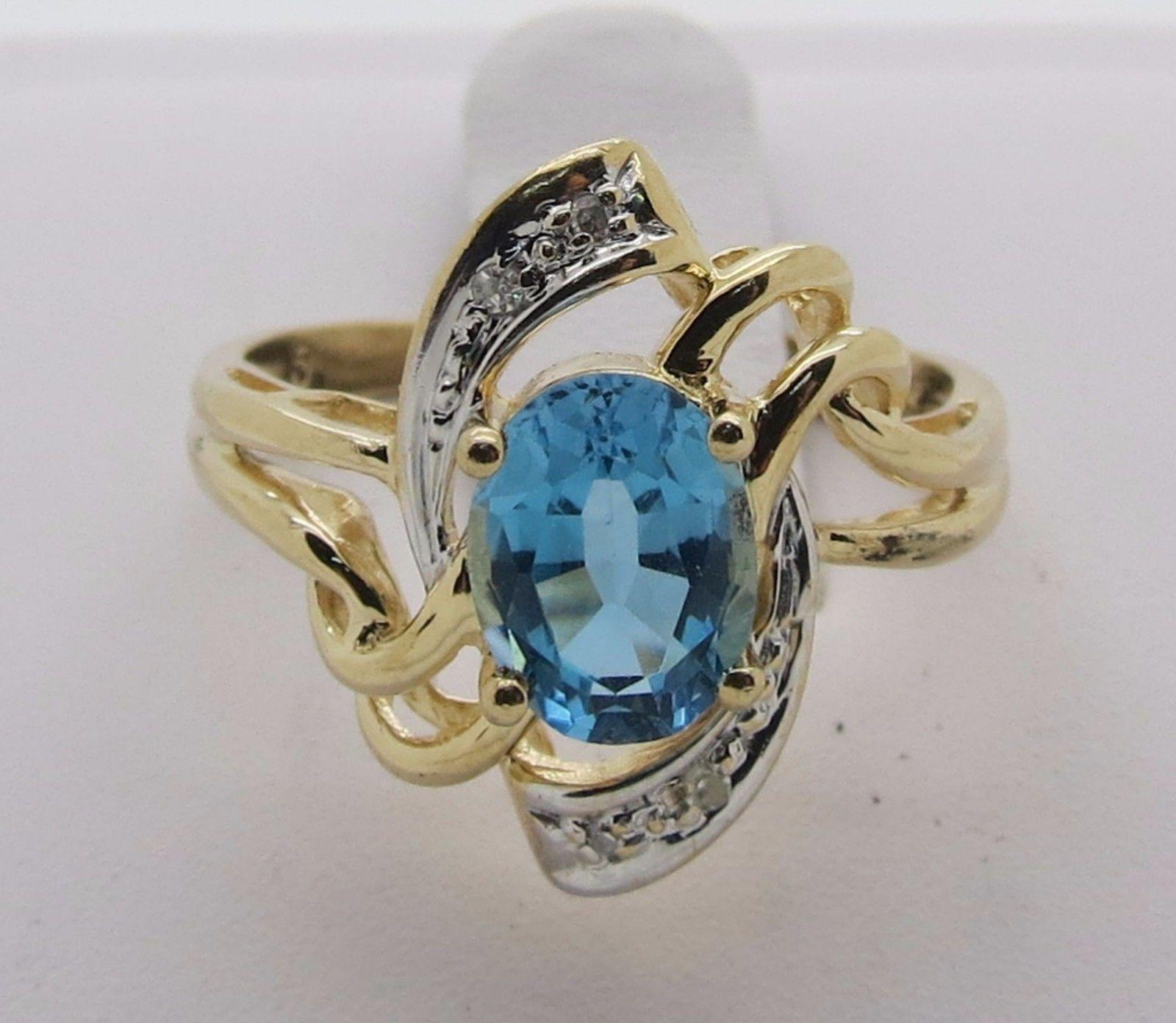 14kt Gold ~ Oval Blue Topaz & 4 Diamonds ~ Ladies Ring~ Size 8 ~