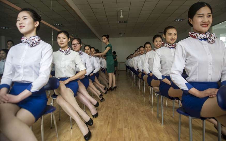 Students of flight attendant major during a training session at Anhui Foreign Languages University, in Hefei, Anhui province, China.