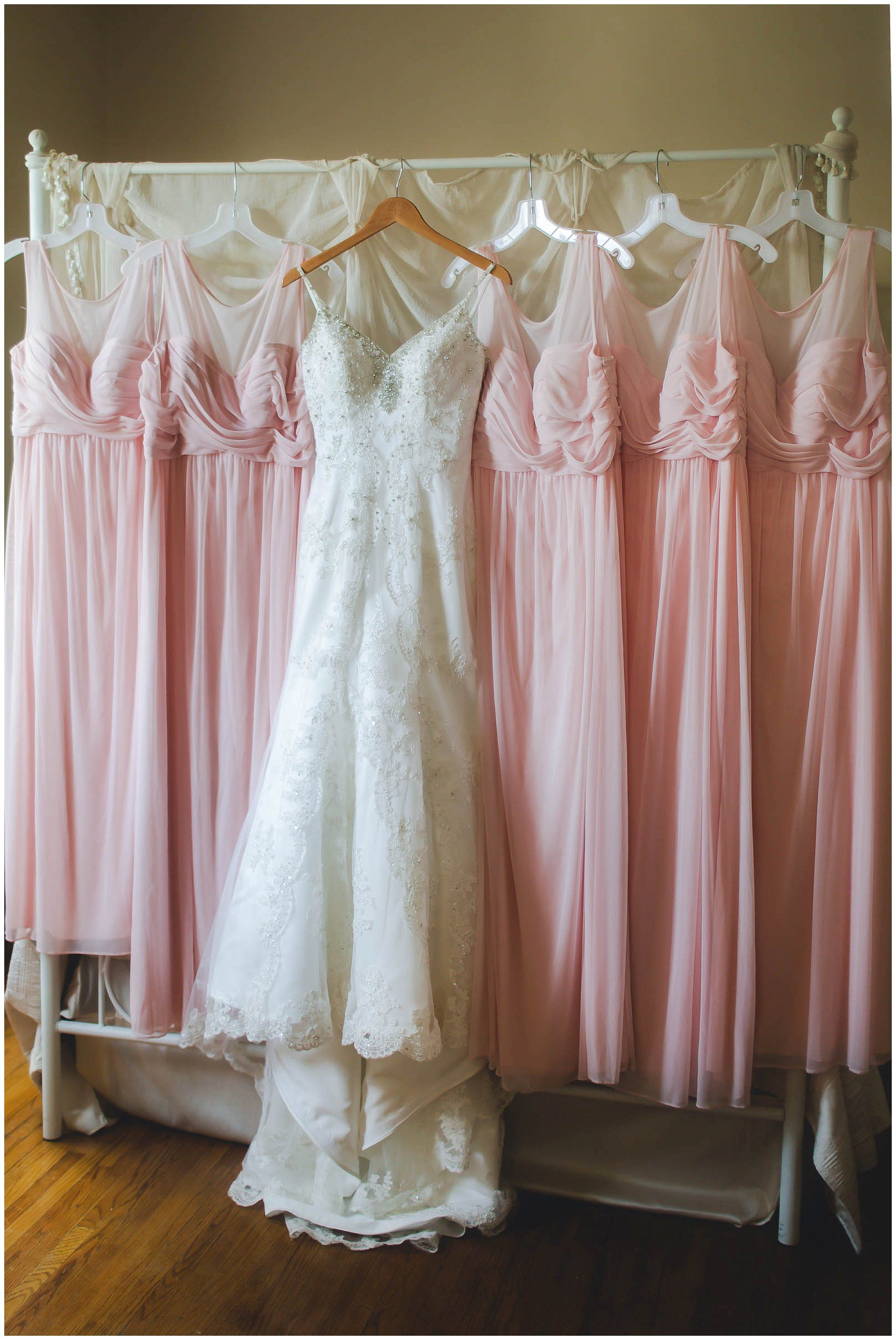85711fe62dc Stunning wedding dress for an elegant pink wedding! Wedding dressing  handing with stunning pink bridesmaid dresses!