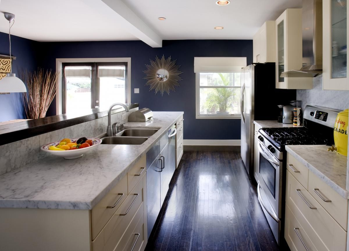 White cabinets are so overused but the dark floors and navy walls make it work contemporary kitchen cultivate com cultivateit