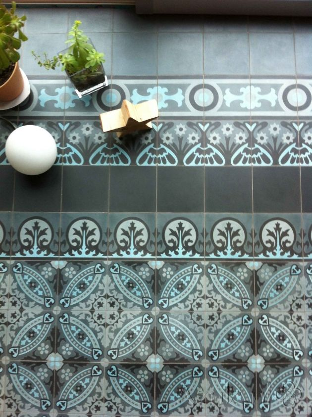 The OS tiles are smaller than the most cementtiles. 14 by 14 cm. But the're in many different borders, colors and motives.
