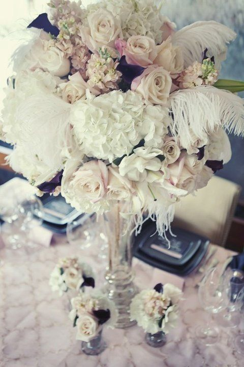 Vintage glam inspiration by couture events entertaining wowe white feathers are a way to incorporate hollywood glamour into your wedding mightylinksfo