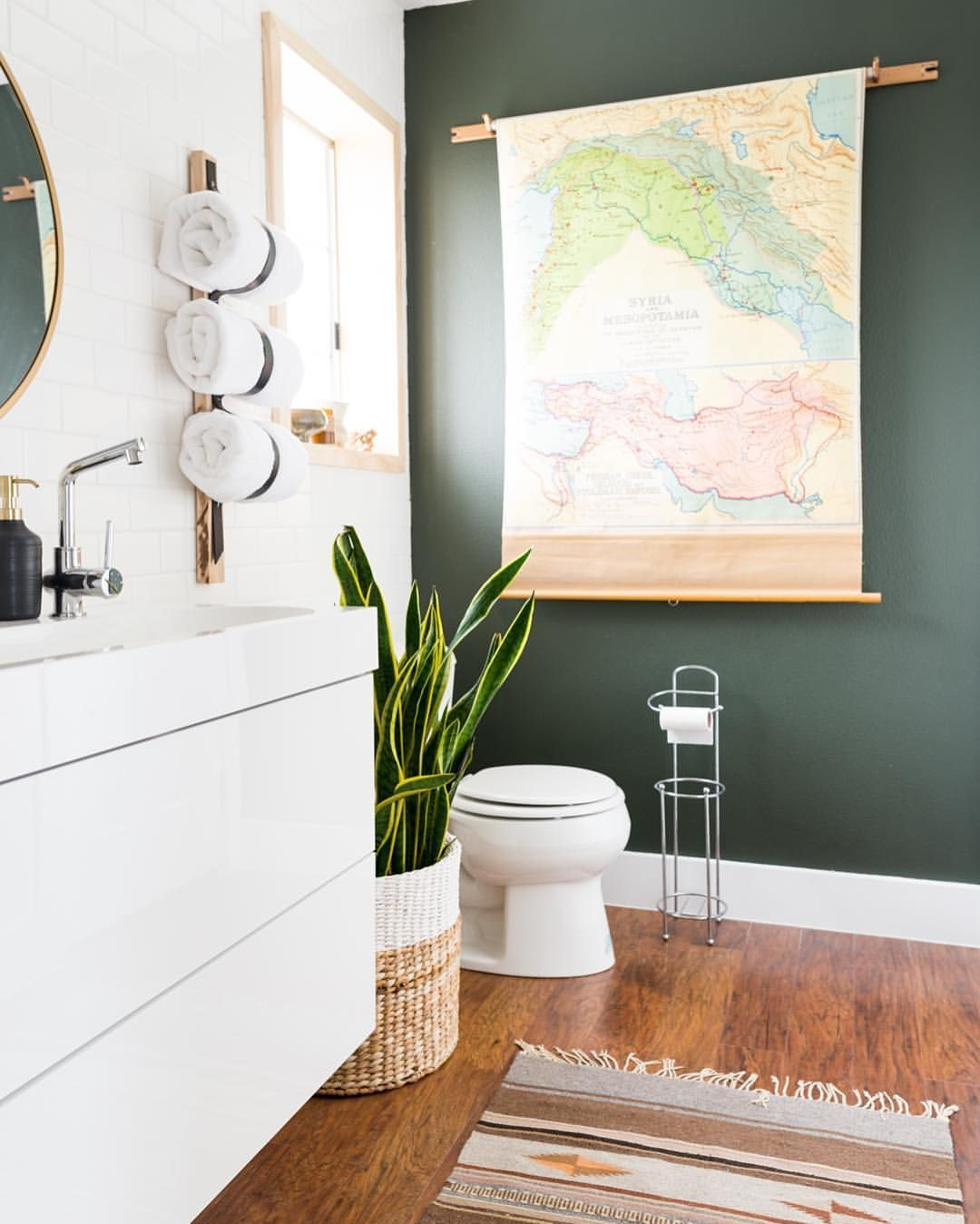 An elegant green and white bathroom with a killer map! /// See this ...