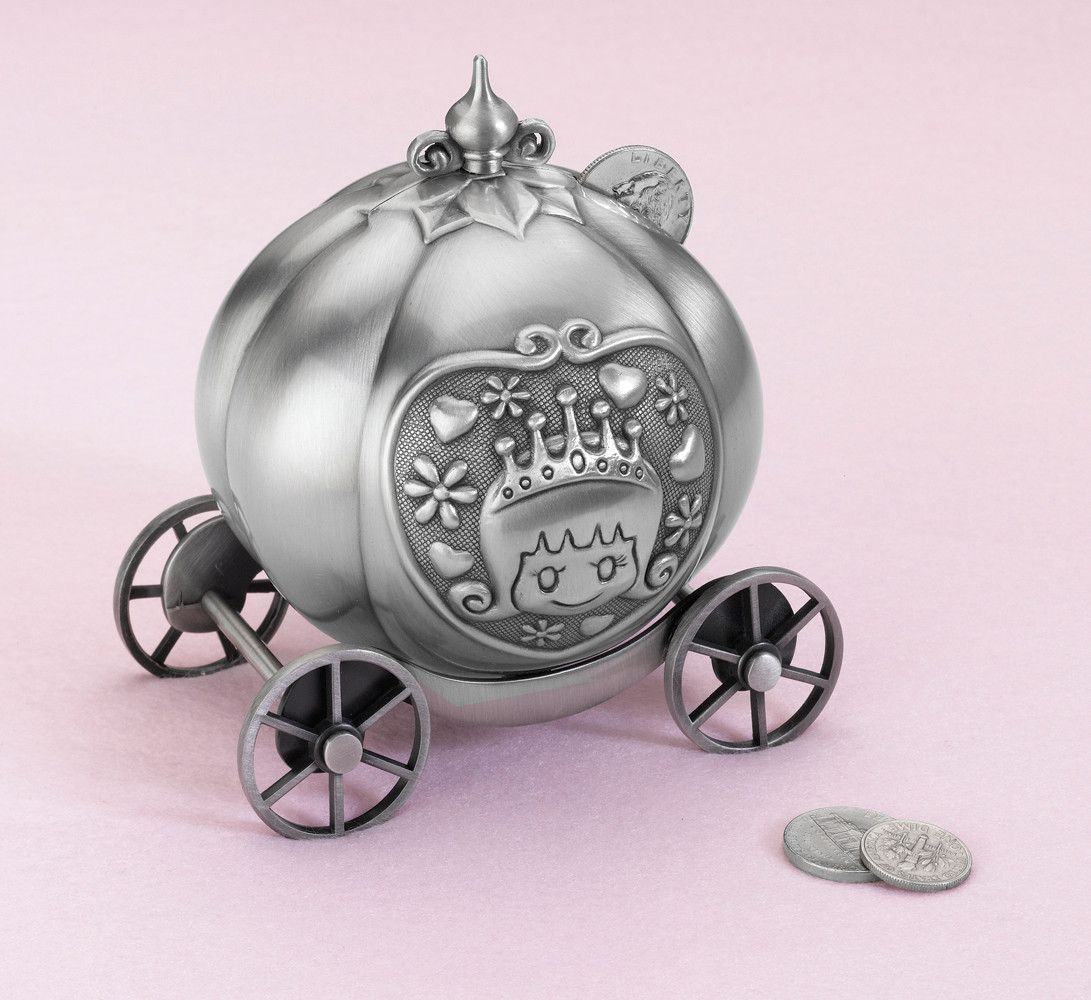 This silver pewter coin bank is designed to look like a
