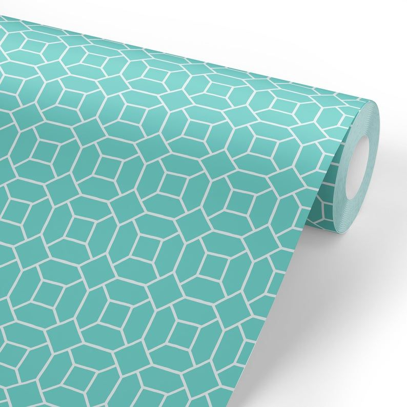 """Featuring a classic geometric interlocking pattern in a combination of bold colors, this peel and stick wallpaper packs a delightful punch!  Choose from 4 colors: teal, red, blue and navy to create your favorite look today! Our wallpaper is self-adhesive and removable material that is made in the U.S.A. and is environmentally conscious and safe.  Our ink is water-based, long lasting and is also 100% non-toxic. Simply peel away the backing of the paper, press the 'sticky' side onto your surface and smooth...no need for messy glues or adhesives.  We find that this paper works best on smooth surfaces. This item is printed-to-order.  Ships in 5-7 business days. How do I know how much I need? First, measure your wall's height in inches…this will determine the roll length you will need to order. Next, measure your wall's width in inches and divide that number by 26…round that number up and this will determine the amount of rolls you need. For example, if your wall measures 8 feet (96 inches) tall you will need the 104-inch roll. If your wall measures 127 inches wide, divide that number by 26 and round up (127/26=4.88)  So you will round up 4.88 to 5 and you will need 5 of the 104"""" rolls."""
