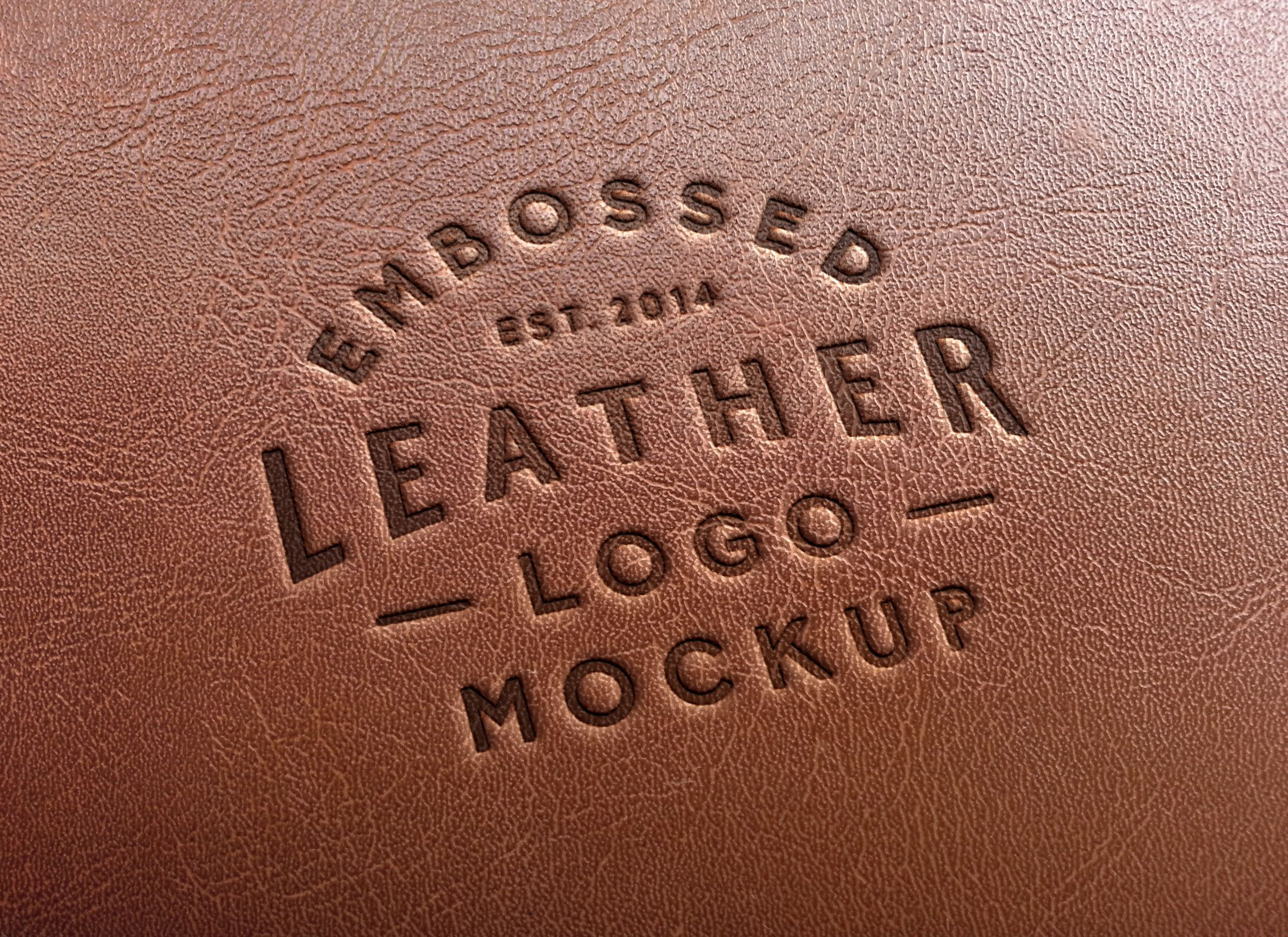 a new realistic embossed leather effect to mock up your logo badge