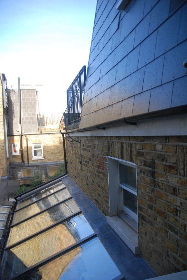 Contemporary shake on similar mansard roof condo for Modern mansard roof