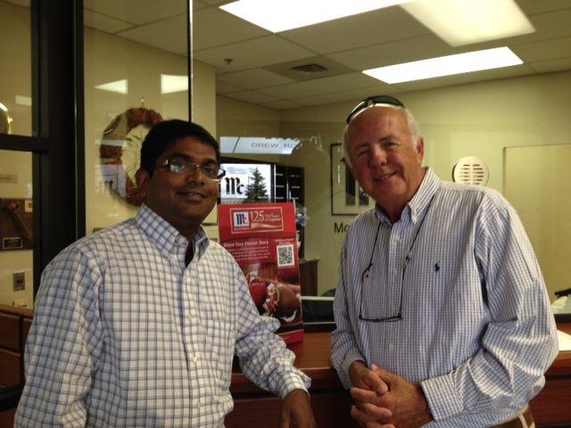 HQO's Al Jones (right) visiting a customer in Canada.