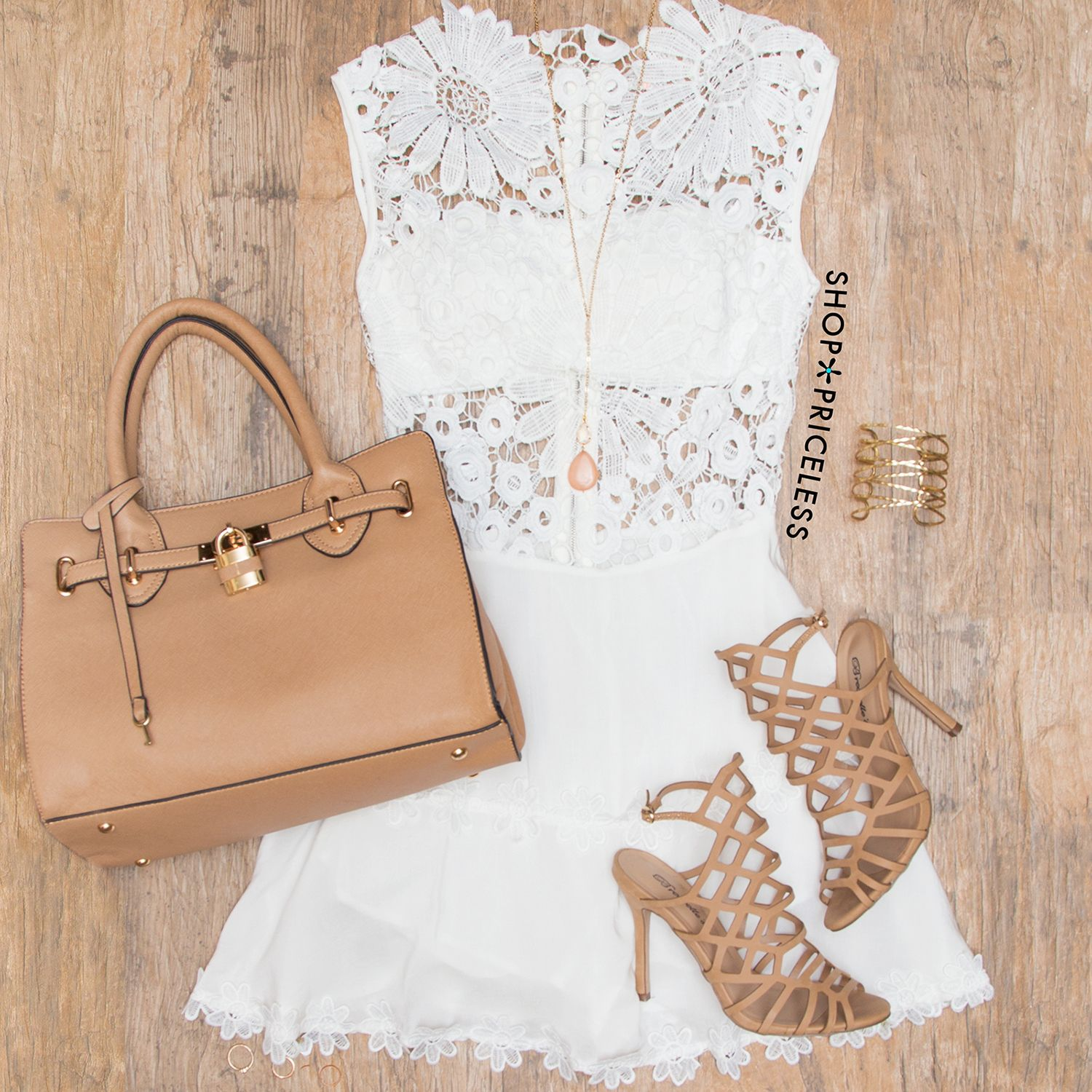 - Details - Size Guide - Model Stats - Contact Girl, go wild for this Lena Flower Lace Dress in white! Features a lightweight knit and crochet and lace fabric with minimal stretch. High neck front wit