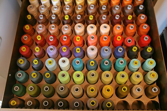 Incredible thread organization, there's more.  This owner is like me....all the colors in a row!