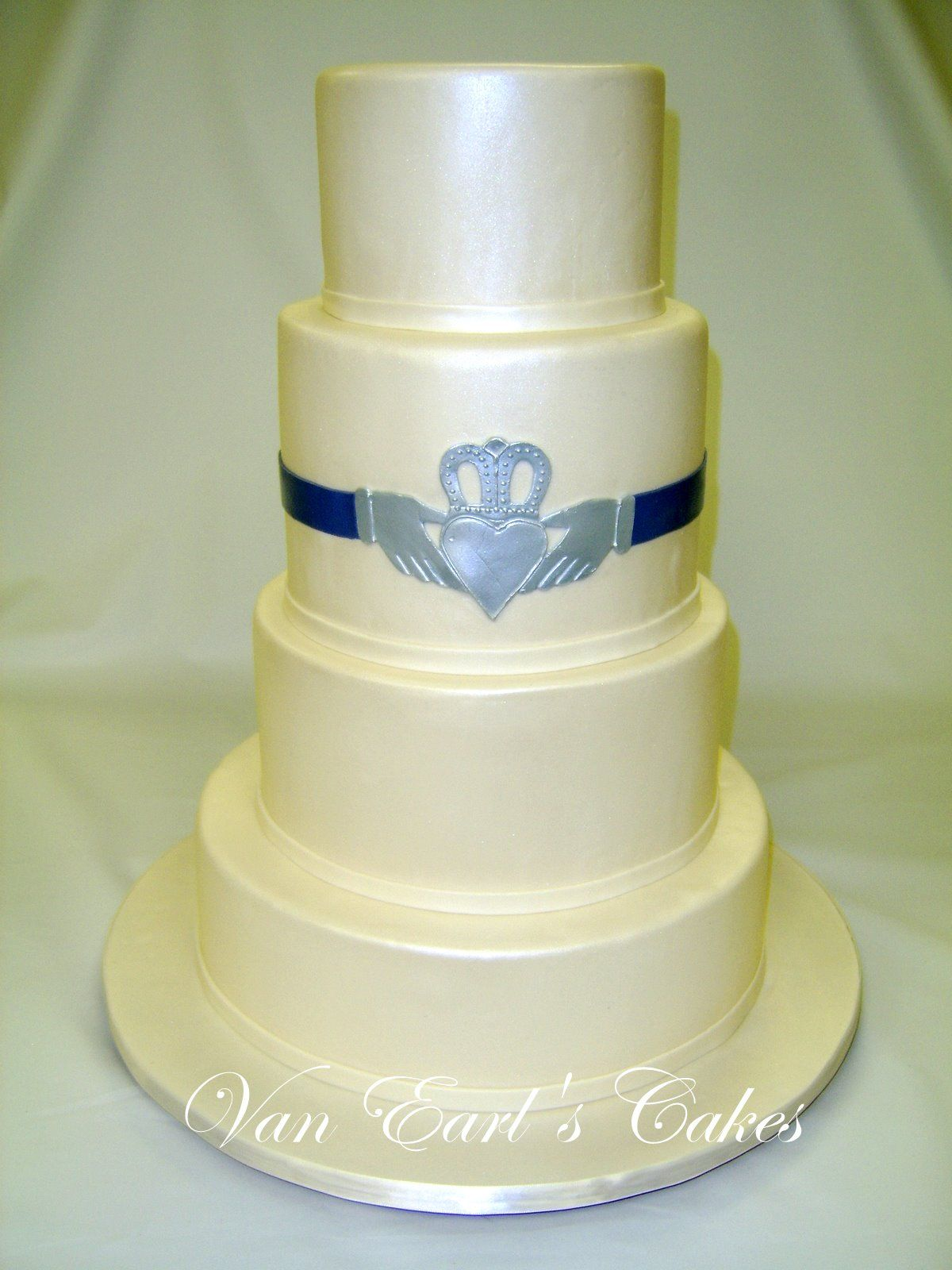 Image detail for -clean and simple four tier ivory wedding cake with a irish ring ...