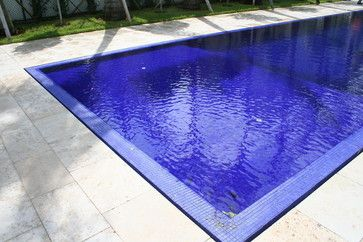 Dark grout with blue pool tiles | Blue pool, Modern ...