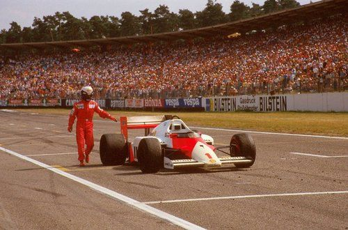 Alain Prost, German GP 1985. His car ran out of fuel on the final corner so he had to push it across the line to secure 6th place