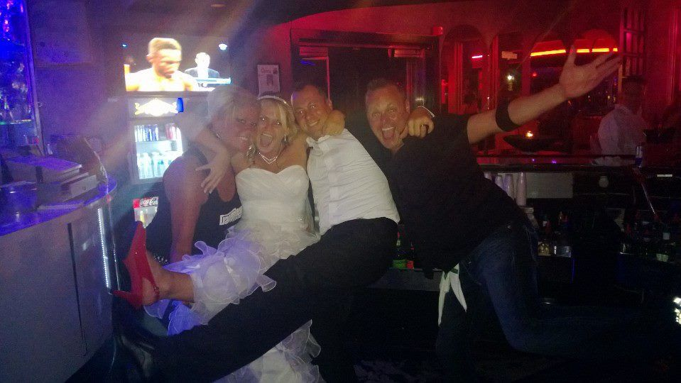 Our bartenders Kristi and Hogan and a beautiful bride and groom - Robin and Kevin!