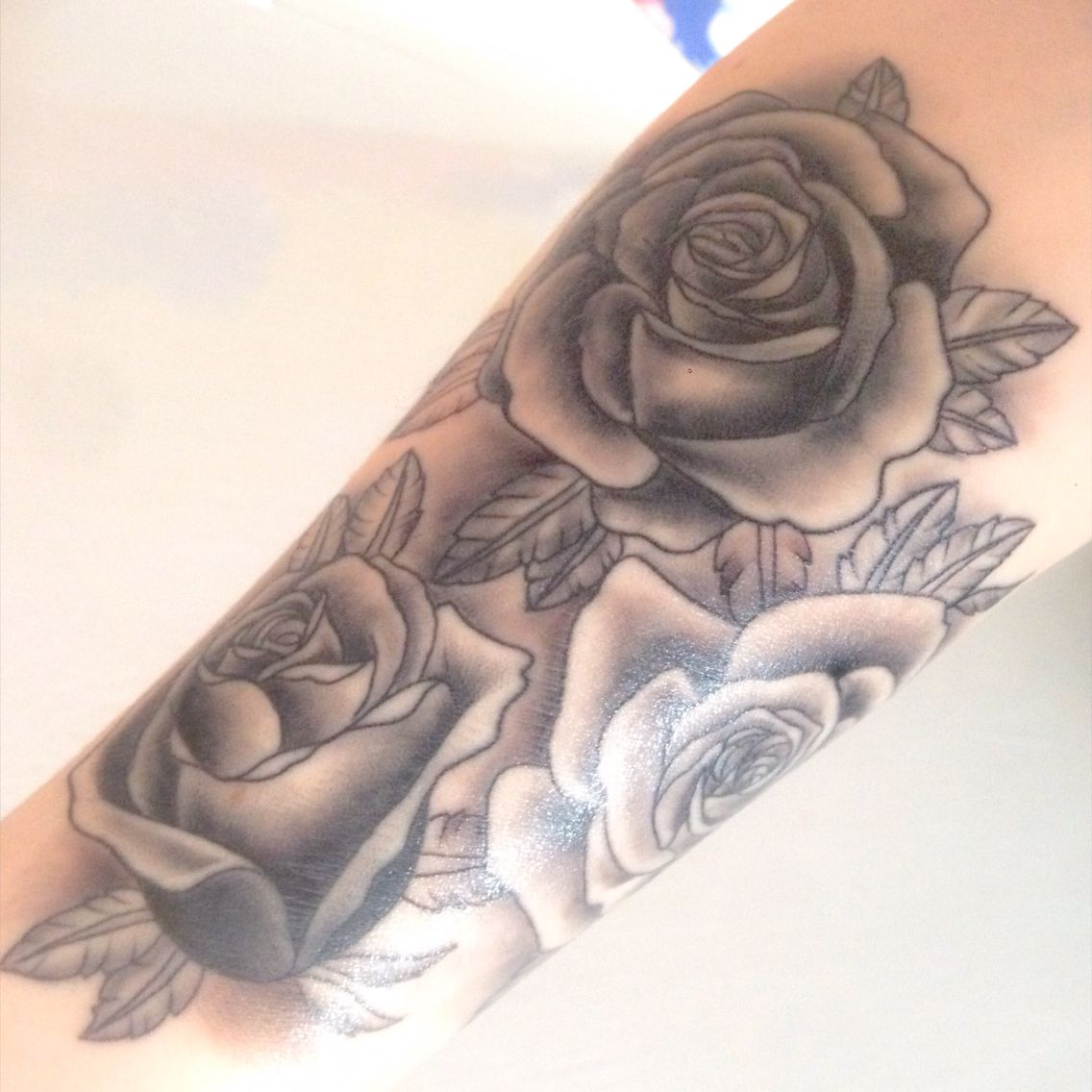 Black rose tattoo on forearm. Signifies my family - Two open roses and one…