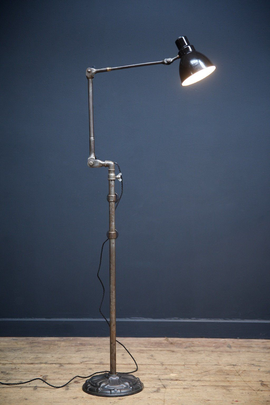 An industrial floor lamp cast iron base with multiple joints to the an industrial floor lamp cast iron base with multiple joints to the steel upright mozeypictures Image collections