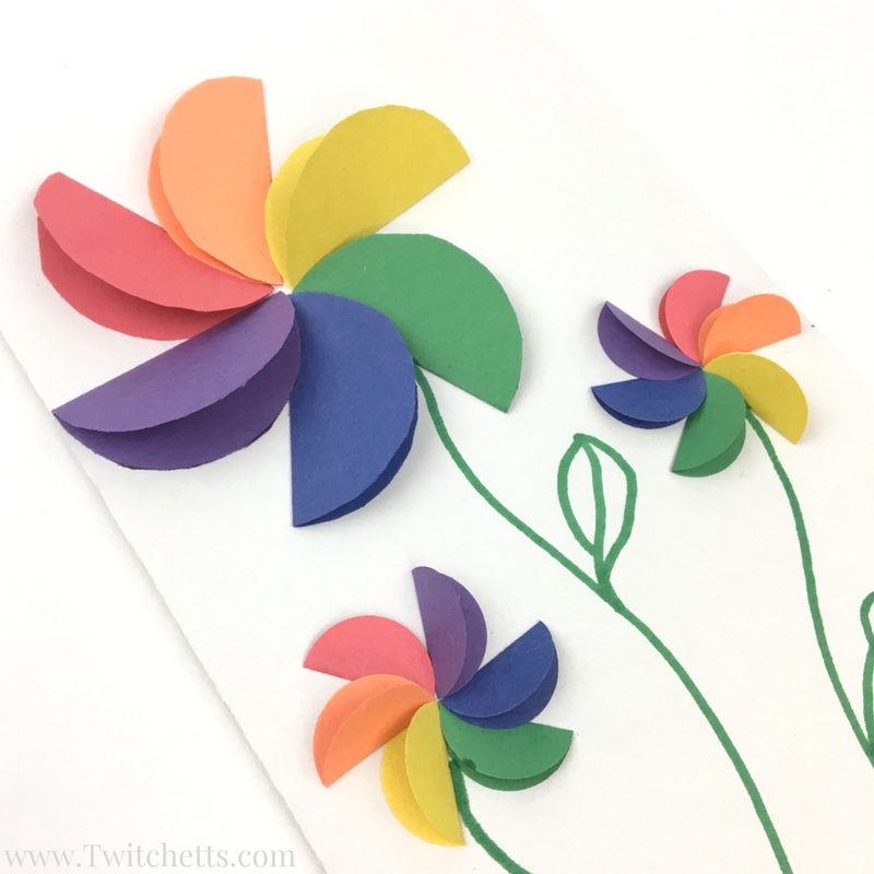 How to make easy rainbow paper flowers for kids cards mothers these construction paper rainbow flowers are perfect diy paper flowers for your kids to make these a fun paper flowers for a kids craft mightylinksfo