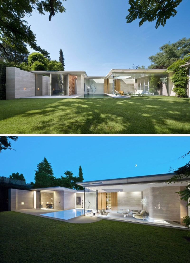 15 single story modern houses glass walls make up the back of this single story house to let in all the natural light and keep the home feeling bright and