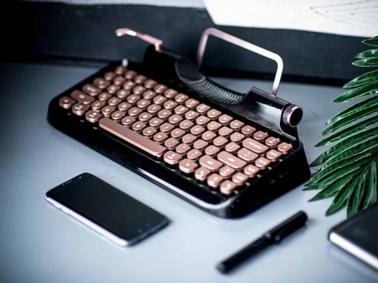 This gorgeous keyboard will give your desk a retro feel with all the modern…