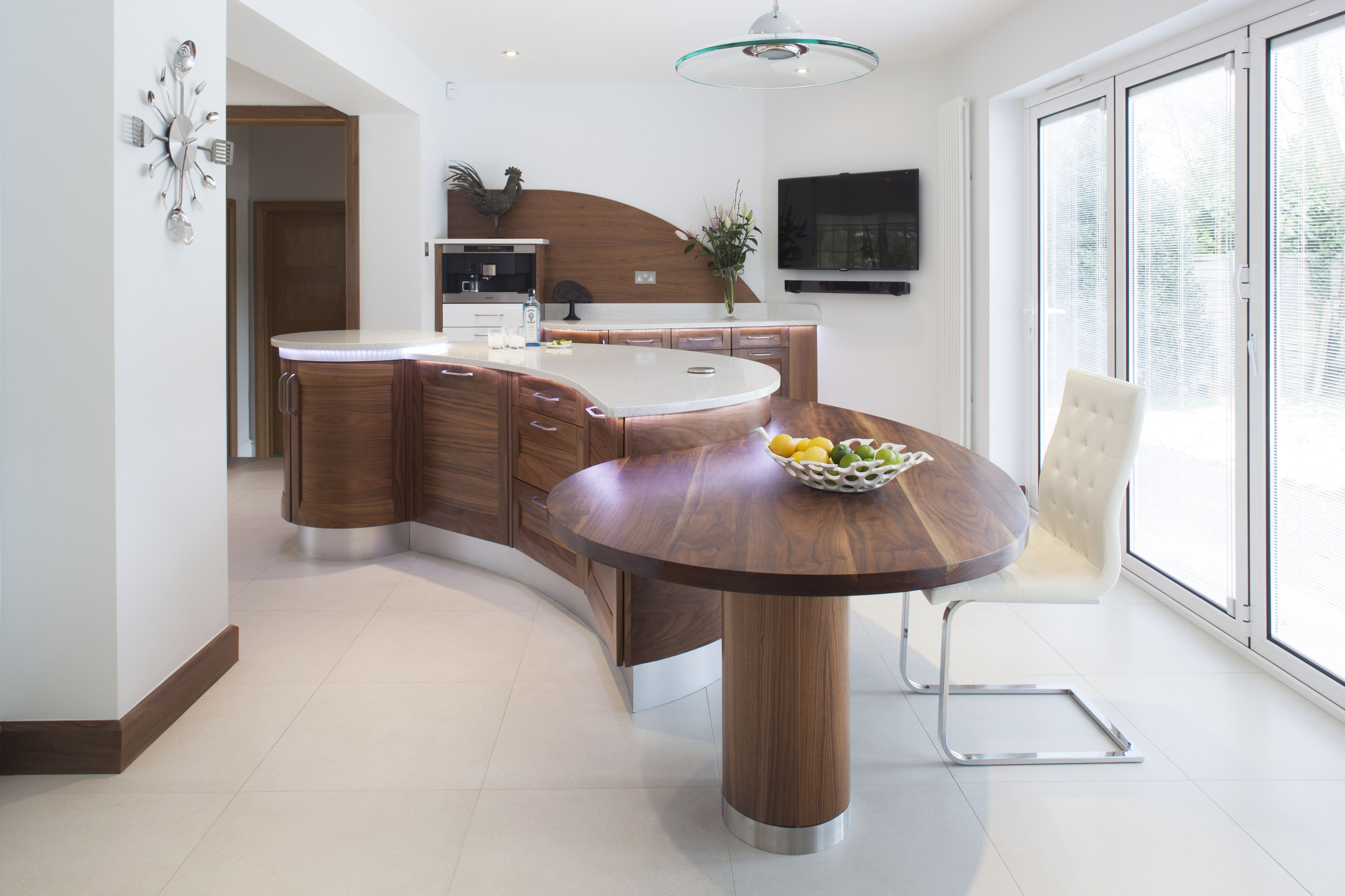 Stunning Stoneham kitchen with sweeping curved island