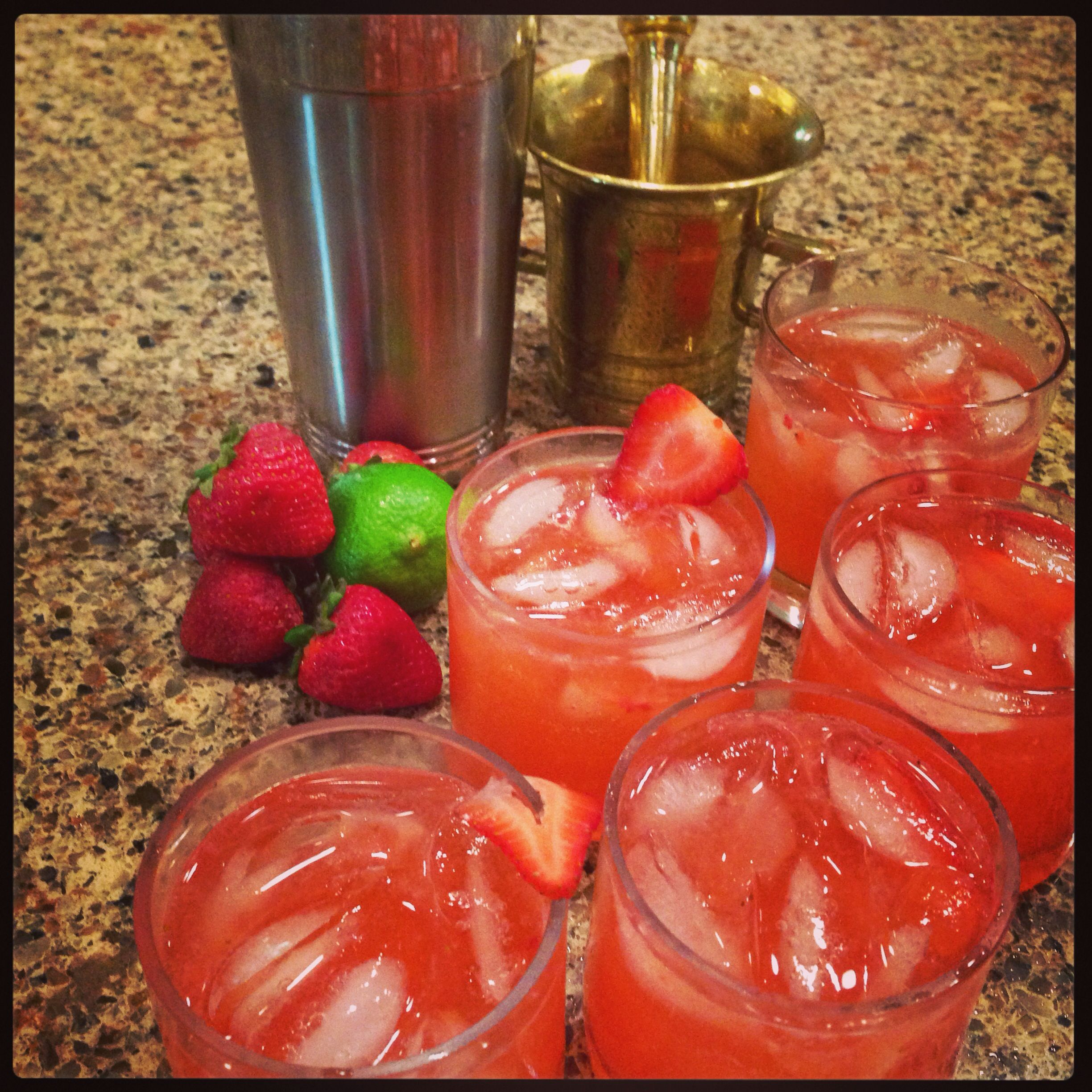 No more slurpee-like drinks. These strawberry daiquiris with fresh squeezed lime and muddled strawberries are the real deal. Cheers!