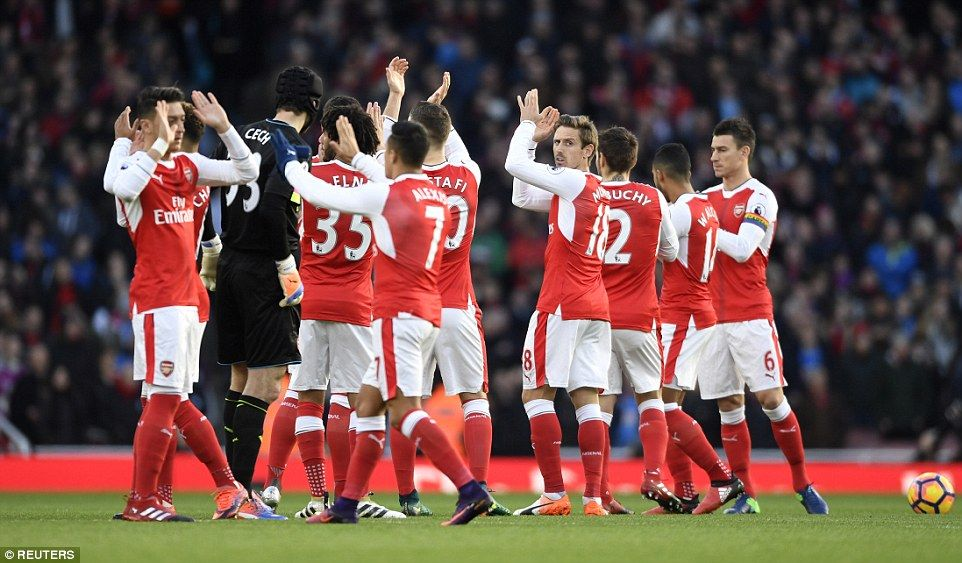 Arsenal players applaud their fans before the Premier League match on Sunday afternoon at the Emirates Stadium