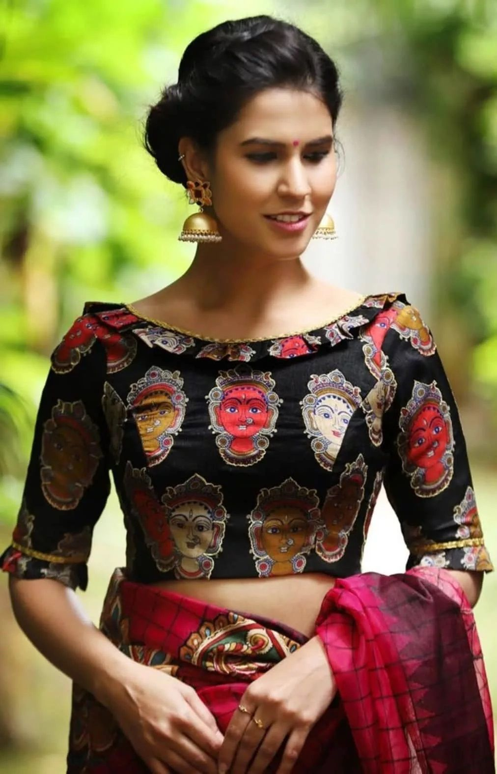 Wedding Blouse Designs - Black boat neck blouse with artistic face-kind print   #blousedesignslatest