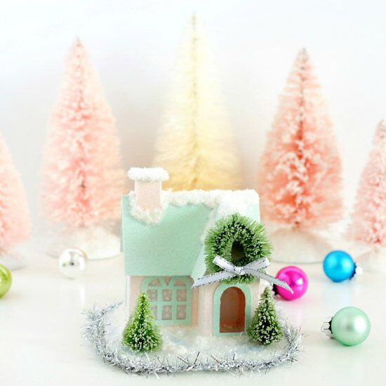 Decorate little paper houses with paint and snow, then finish with a glittering frosty sheen.