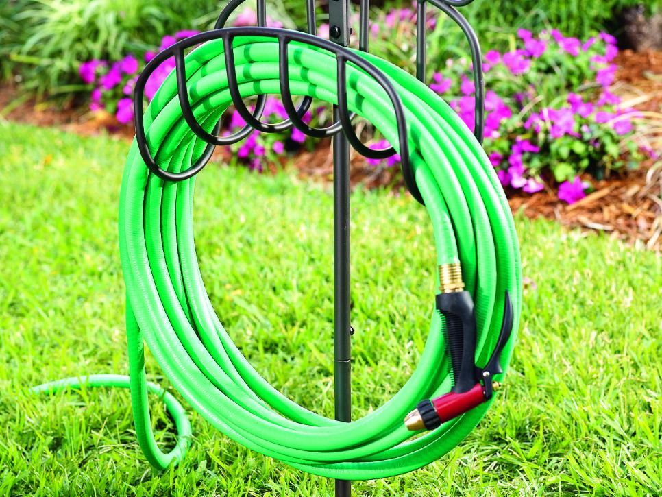 Tired Of Having A Tangled Mess Of A Garden Hose Check Out These Storage Solutions To Keep Your Hose Neat An Garden Hose Holder Garden Hose Storage Hose Holder