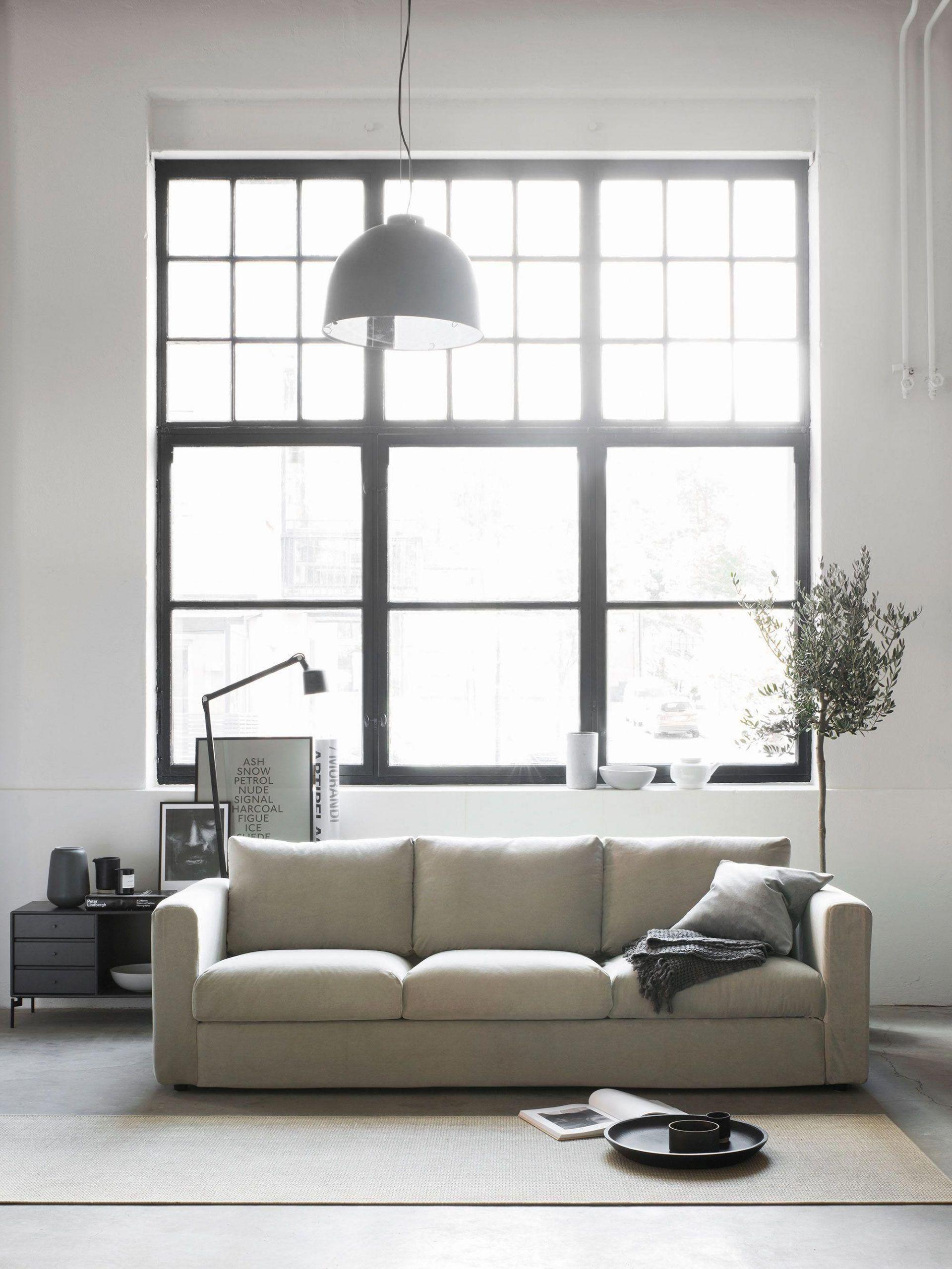 modern industrial style living room  beige velvet sofa  modern