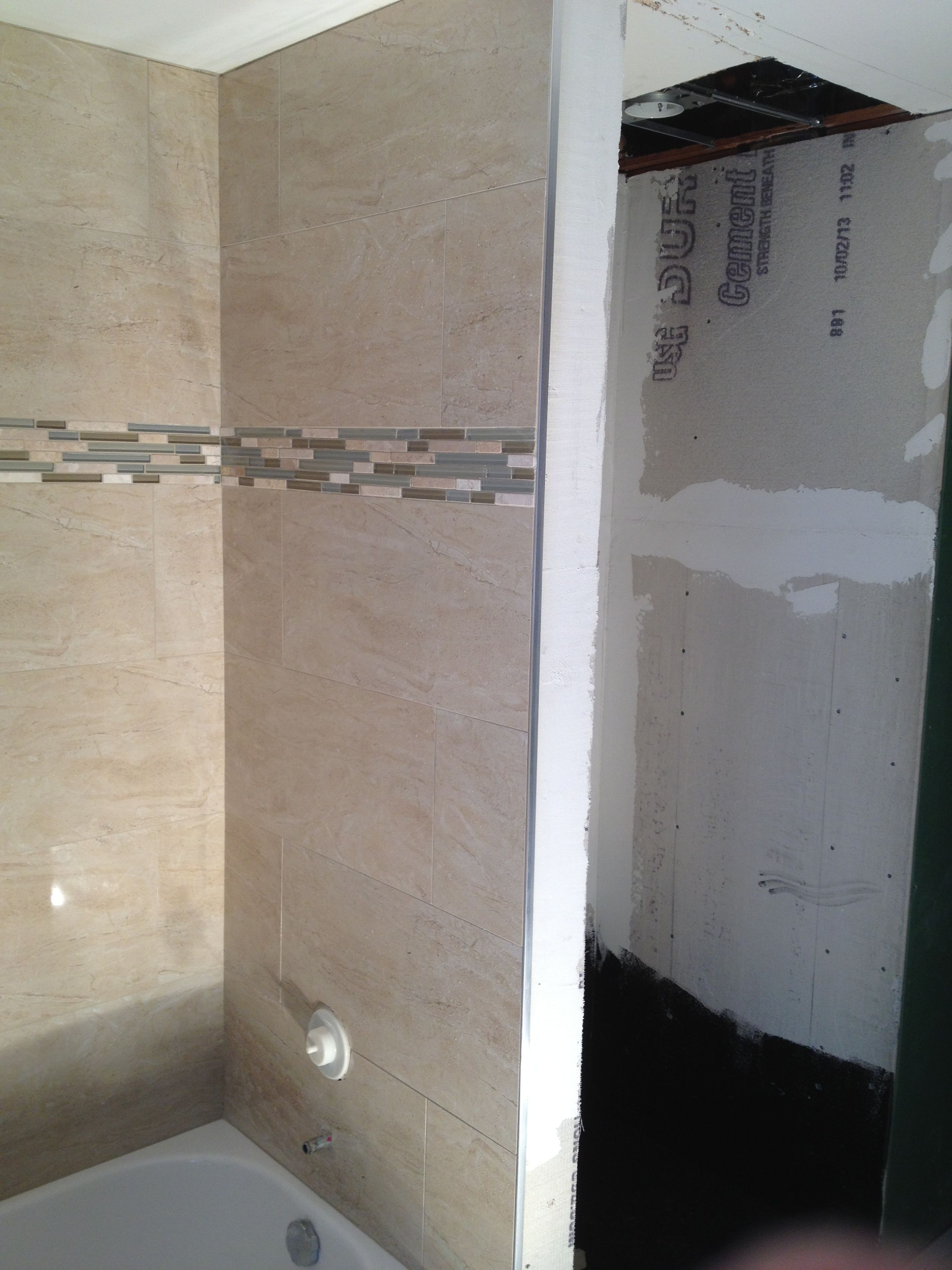 A tub surround we installed 12x24 porcelain tile on a brick pattern ...