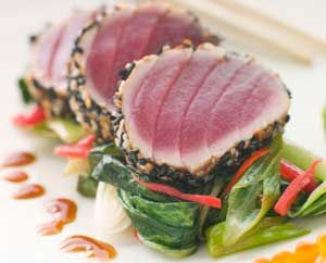 Why we love sesame crusted tuna 1. Quick and easy. 2. Very healthy: high in protein and omega-3s. 3. Serve with your choice of steamed greens, rice or noodles. SEE ALSO: TUNA AND SWEETCORN FRITTERS Ingredients Serves 4 4 tuna steaks 4 tbsp sesame seeds 2 tbsp honey 4 tbsp dark soy sauce 2 cloves garlic, crushed 1 thumb-sized piece ginger, grated Coconut oil, for shallow frying Sesame oil and soy sauce, to serve Pak choy and broccoli, to serve SEE ALSO: LEMON AND BASIL SWORDFISH Directions 1…