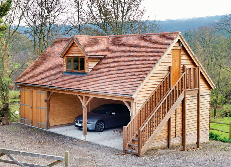 Two storey timber garage with one enclosed bay and an