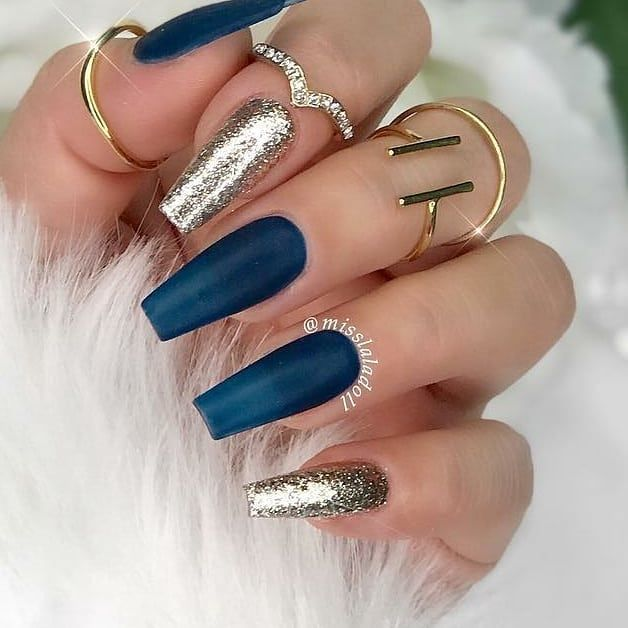 Coffin shaped nails with dark blue and gold glitter gel polishes ...