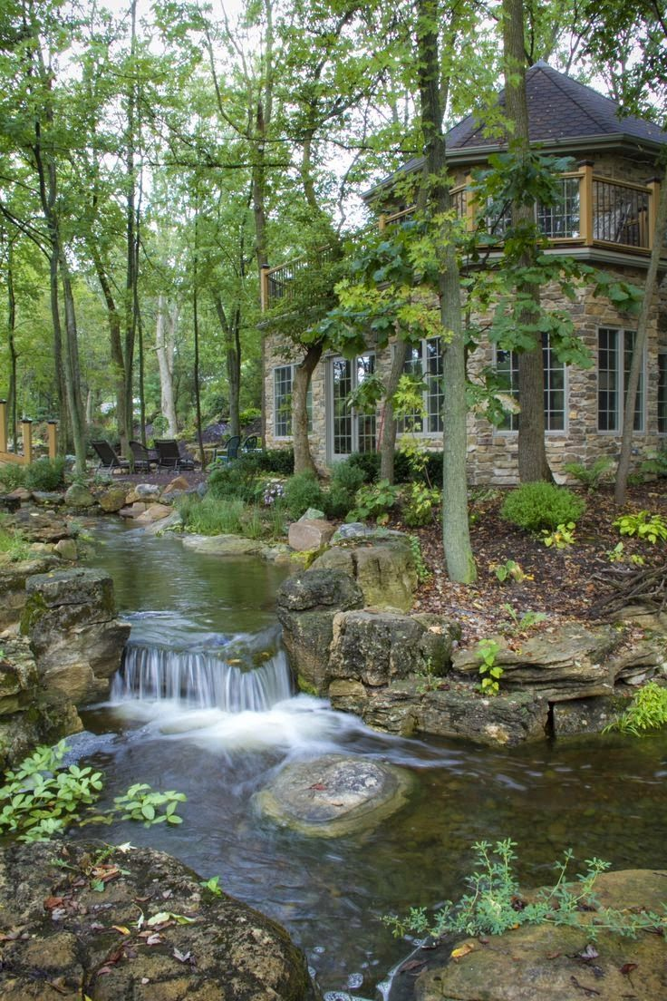 waterfalls and streams run throughout the backyard property of