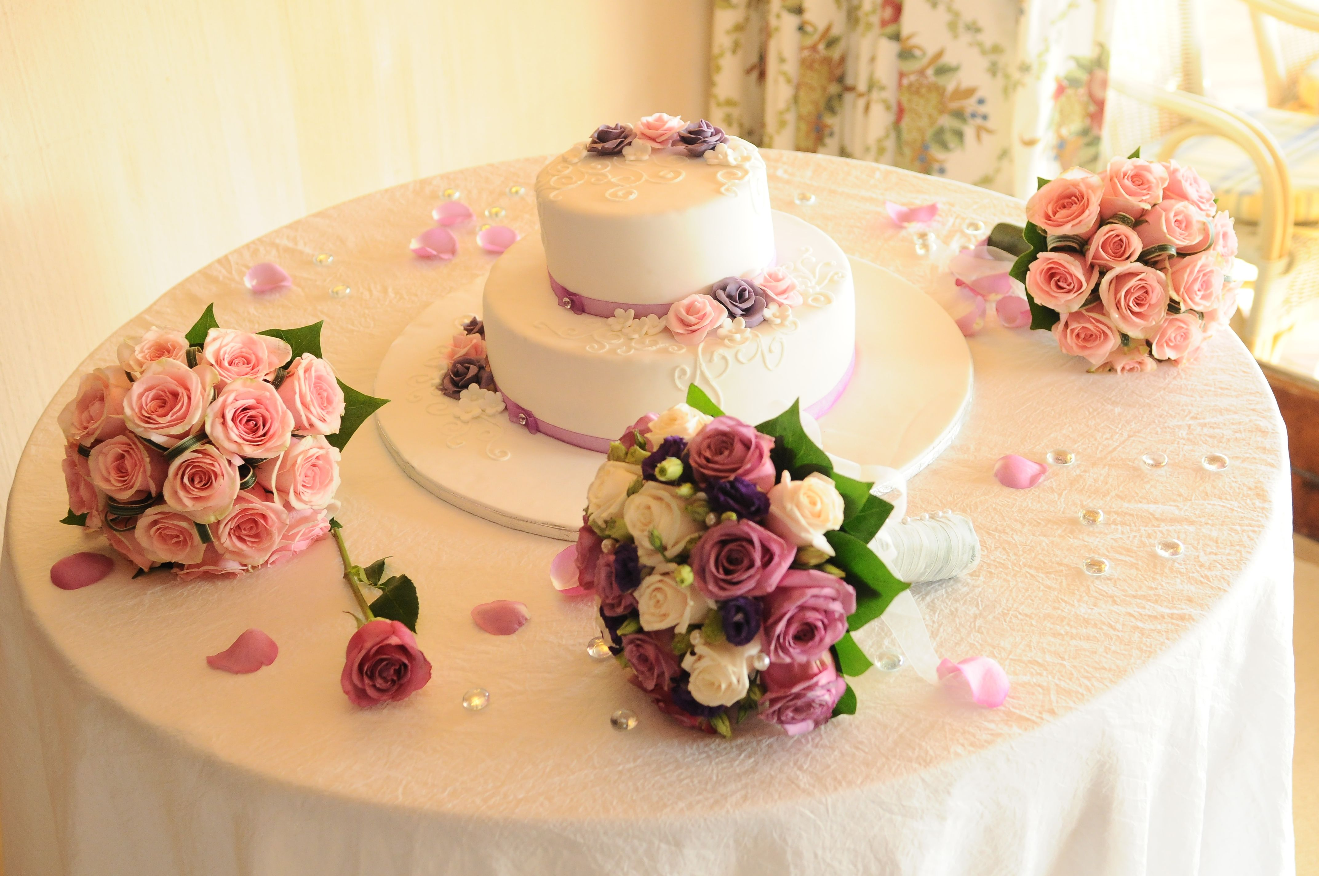 White wedding cake with pink and purple roses by Algarve Wedding ...