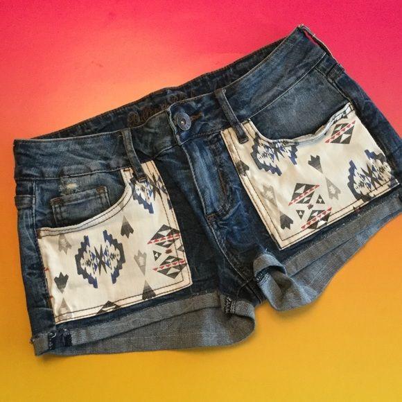 Bullhead Black Jean Shorts  Bullhead Jean Shorts with Aztec Navajo Indian pockets. Cuffs are sewn into place.Medium colored denim with some distress. super cute. Size 1. Bullhead Black CA Trading Company. Great condition. Bullhead Black  Shorts Jean Shorts