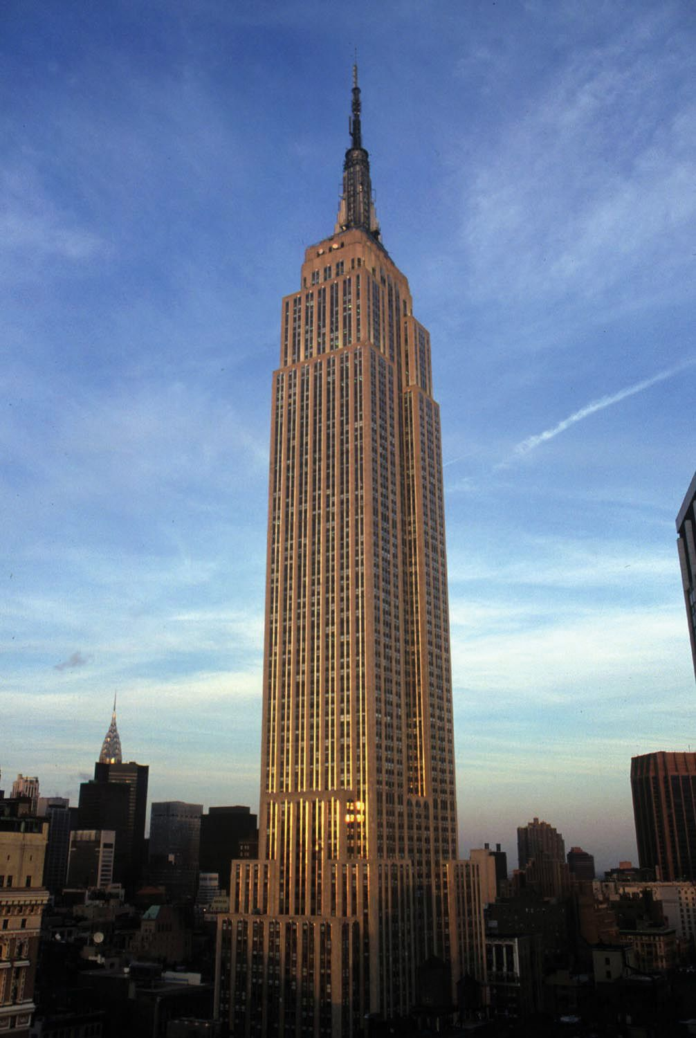 Stand at the top of the empire state building visit for Beautiful places to visit in new york state