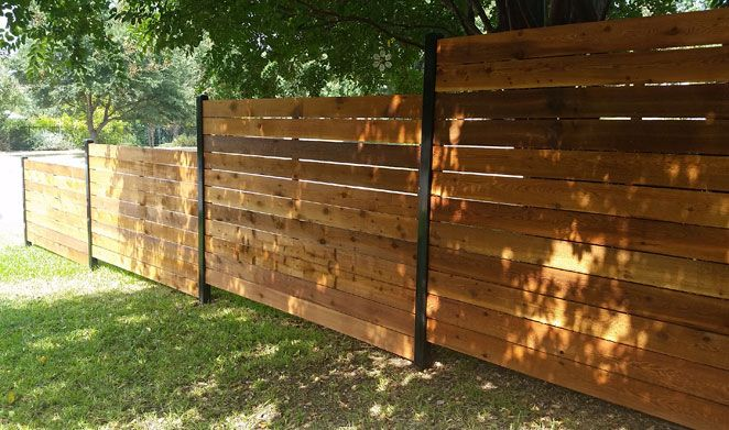 Horizontal Style Fence With Black Posts Stained Wood