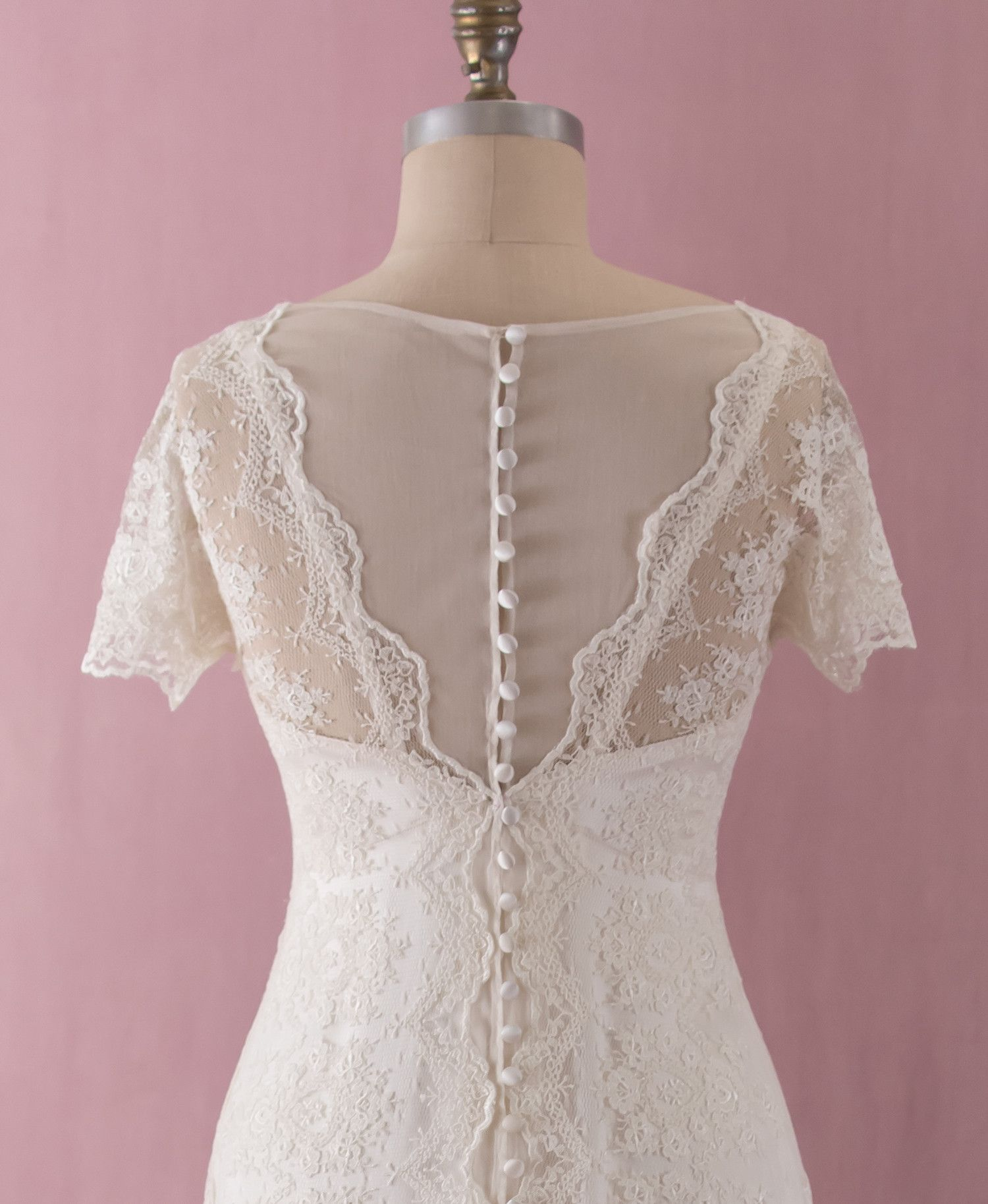 Mia by Martin McCrea   Venise pattern embroidered tulle wedding dress in an asymmetrical wrap style with cap sleeves and satin button back closure. Double silk charmeuse slip dress in 1930's design can be worn separately as an evening gown.