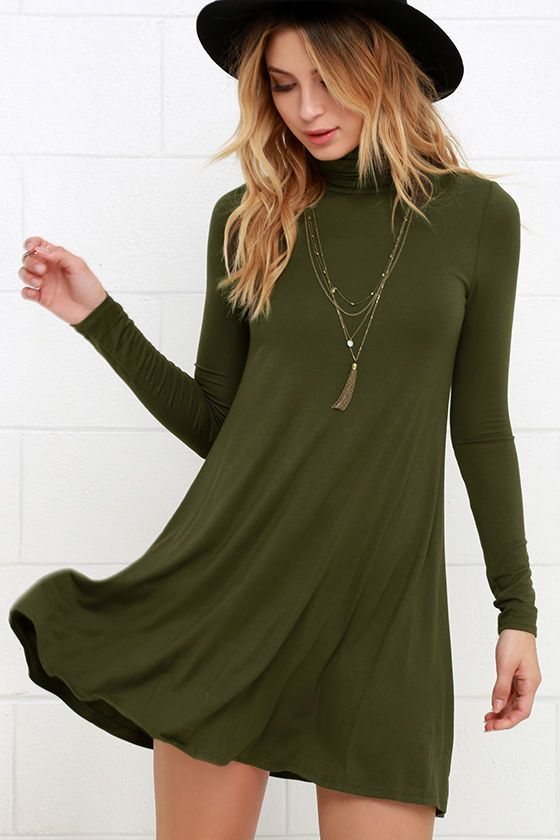Super soft jersey knit fabric shapes a relaxed turtleneck and long, fitted sleeves, while a swing style bodice flares below for a darling finish.