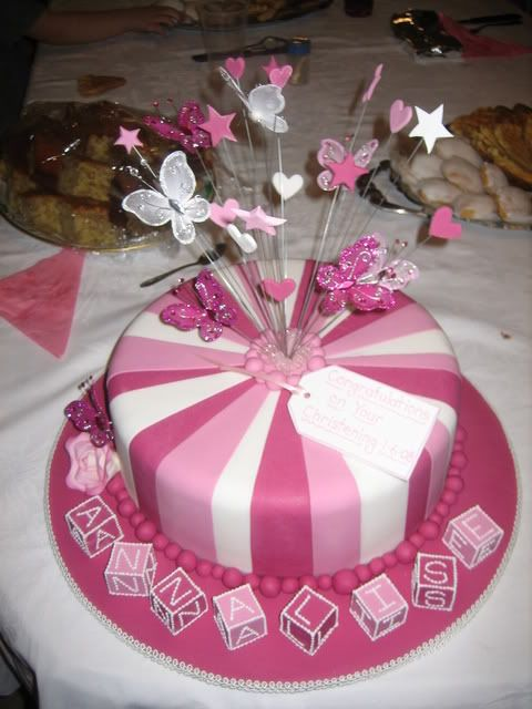 Girls namming day cake with butterflies