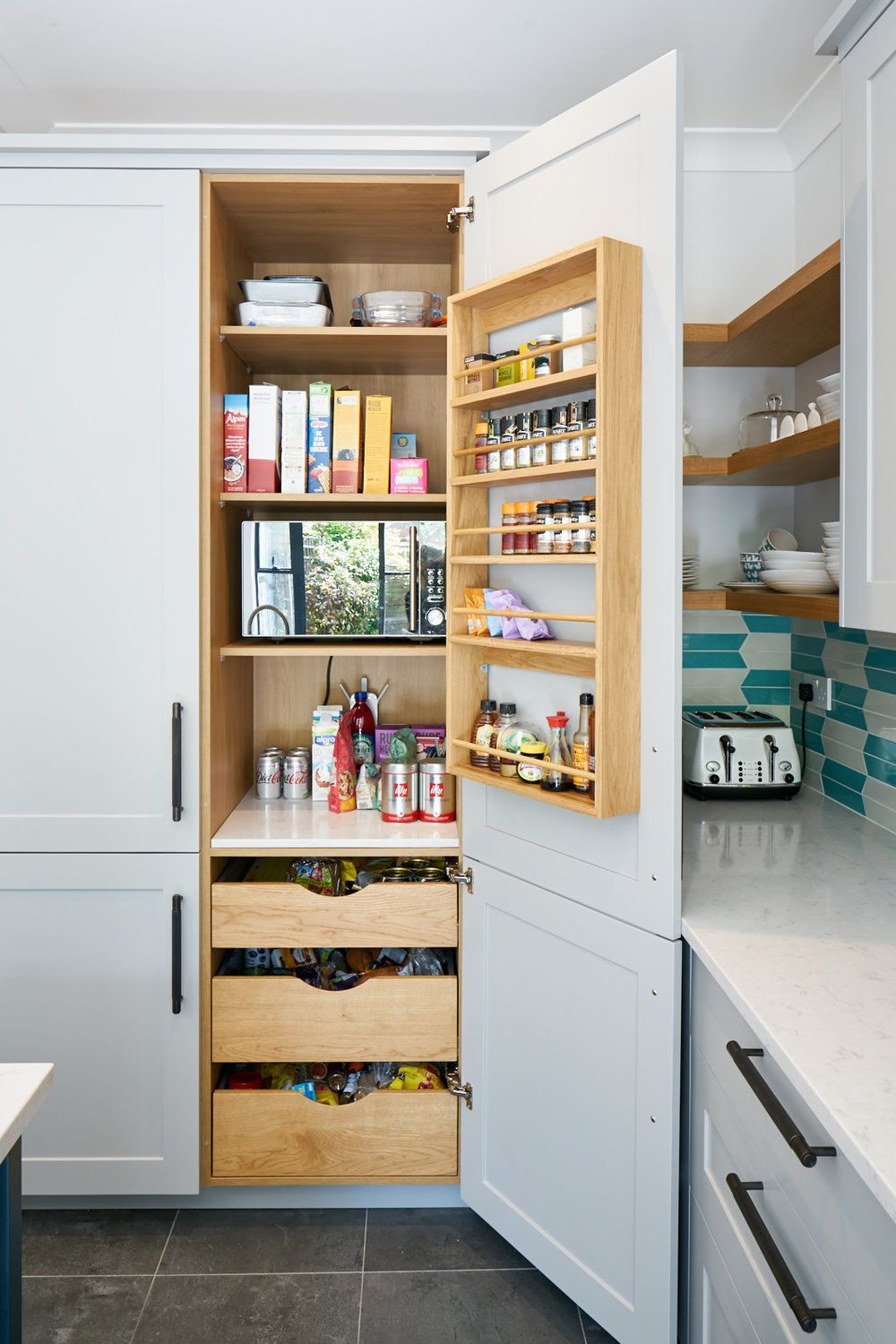 Spice Kitchen Frankfurt shaker larder in purbeck with oak spice rack and