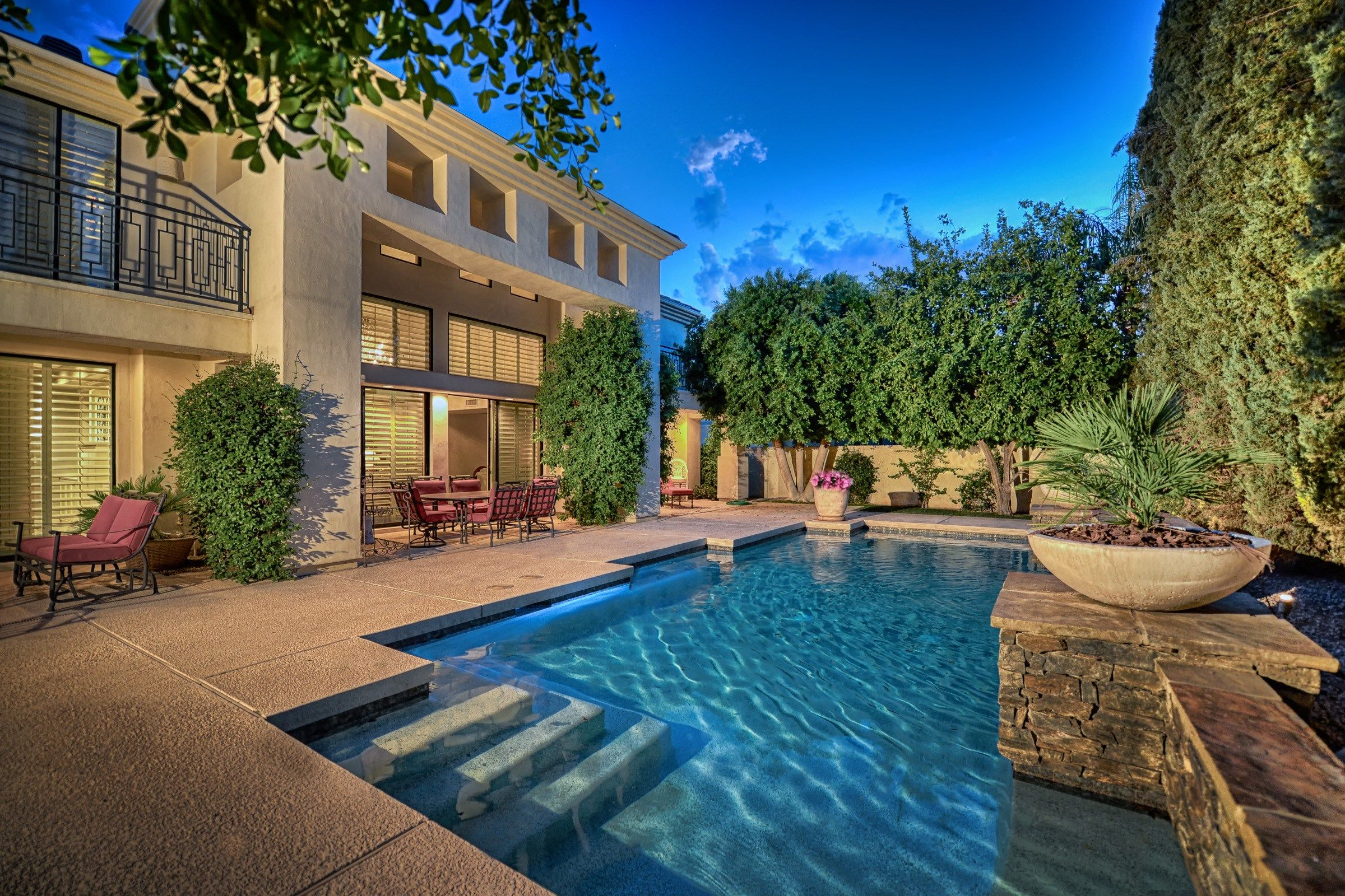 backyard retreat with mature landscaping and sparkling pool