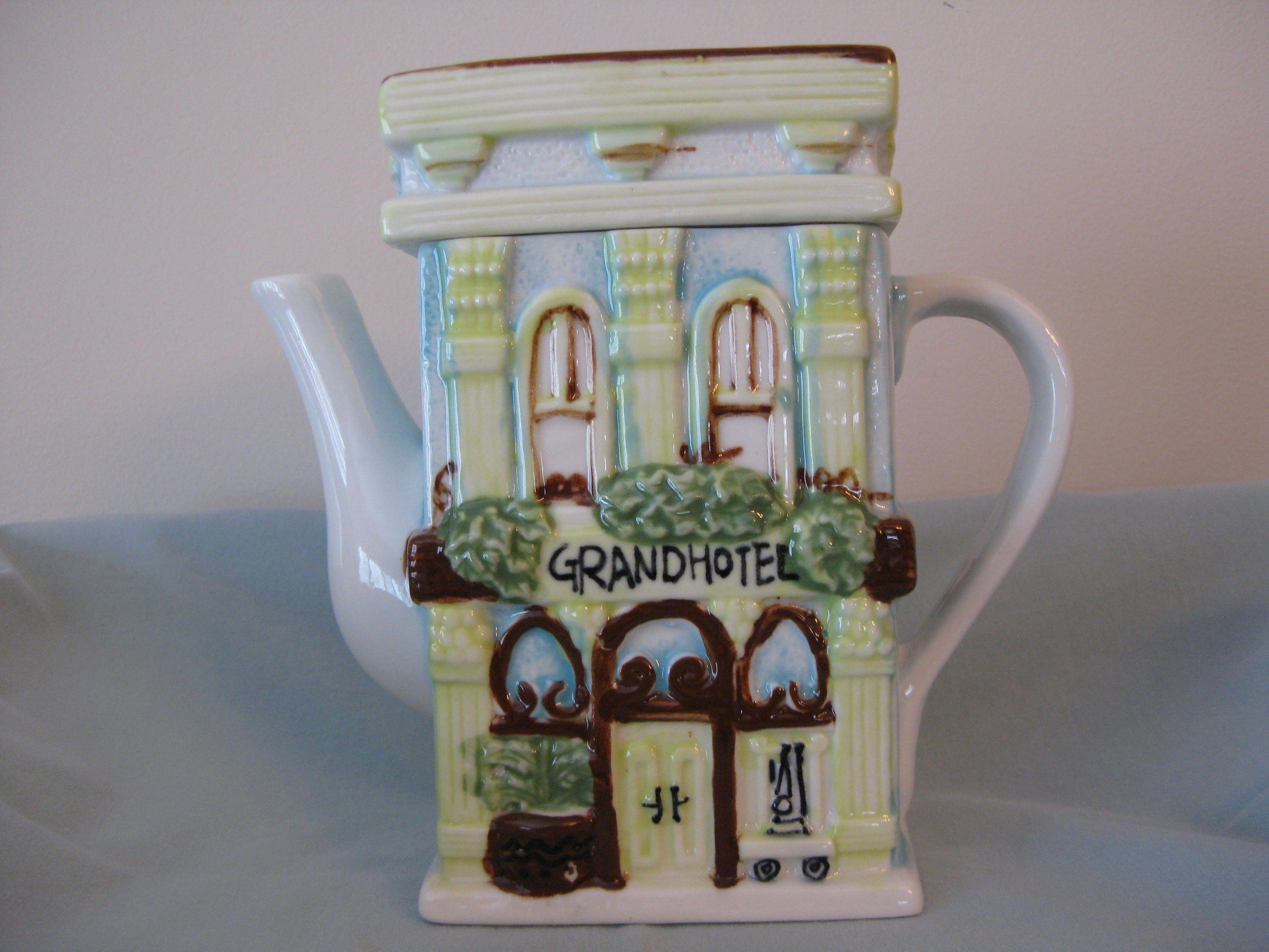 "Front of Grand Hotel. My first ""door"" teapot. No markings."