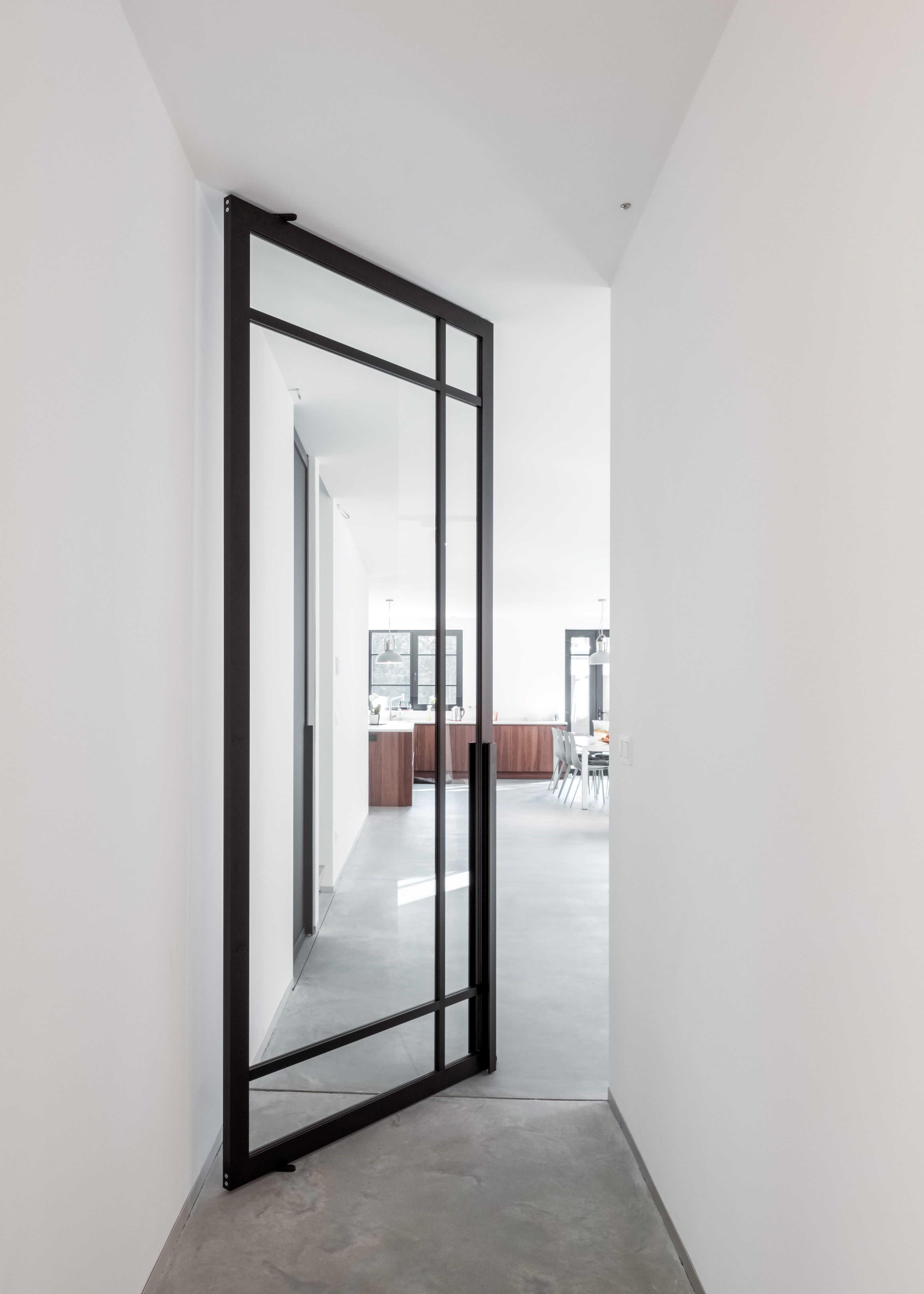 Glass pivot door made with the