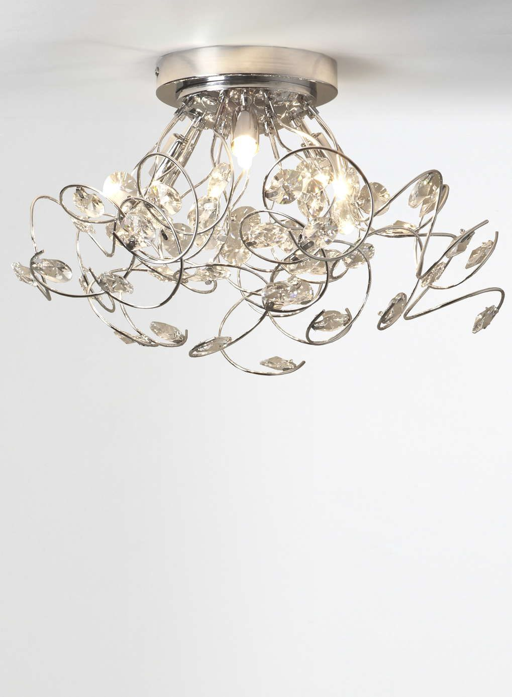 A stunning dynamic ceiling fitting with twirling arms decorated a stunning dynamic ceiling fitting with twirling arms decorated with twinkling crystals description from aloadofball Image collections