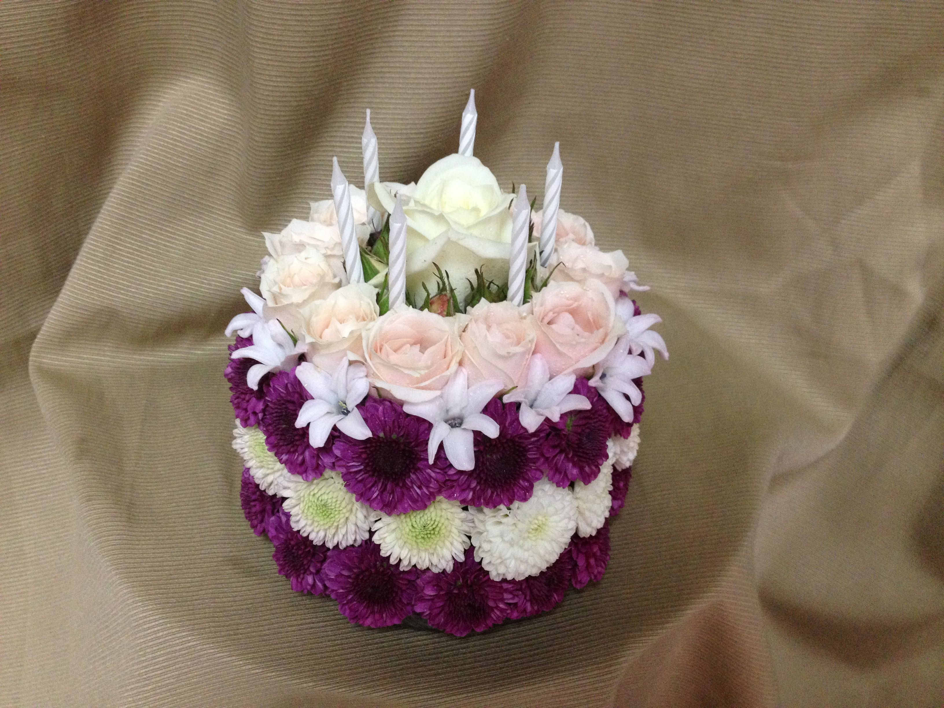 Happy birthday celebrate with a birthday cake made out of flowers happy birthday celebrate with a birthday cake made out of flowers using purple and white button mums purple hyacinth blossoms pink spray roses izmirmasajfo