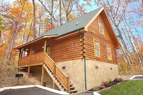 Git-R-Done is a beautiful cabin rental just minutes from all the attractions in Pigeon Forge, TN.  This cabin features a king size bed with a jacuzzi tub, pool table, fireplace, BBQ grill, washer/dryer, and hot tub.  Perfect for a small family or a couple's romantic getaway!